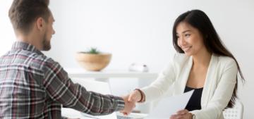 man woman interview shake hands