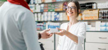 pharmacy lady hands medication