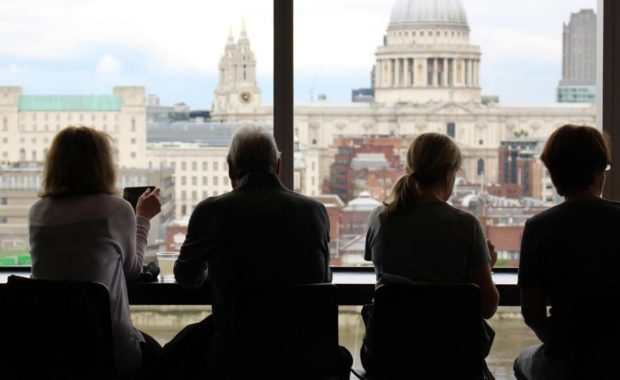 people sitting at a window answering behavioural interview questions